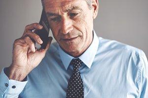 Mature businessman having a conversation on a cellphone