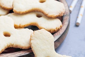 Homemade shortbread cookies made in trendy spinner toy form and glass of milk, vertical