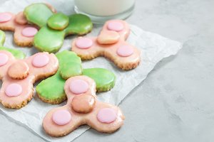 Homemade shortbread cookies made in trendy spinner toy form and glass of milk, horizontal, copy space