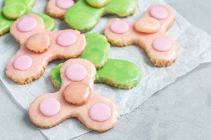 Homemade shortbread cookies, made in trendy spinner toy form, horizontal, copy space