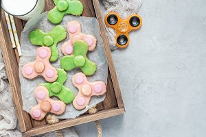 Homemade shortbread cookies in trendy spinner toy form, horizontal, top view, copy space