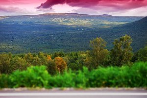Norway mountain transportion road with bokeh and pink sunset bac
