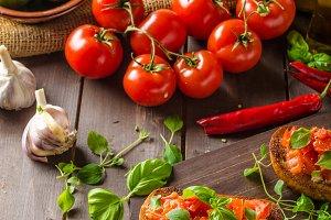 Italian bruschetta with roasted tomatoes and garlic