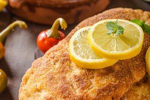 Chicken schnitzel with croquettes