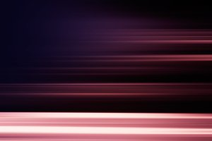 Horizontal motion blur dark red background