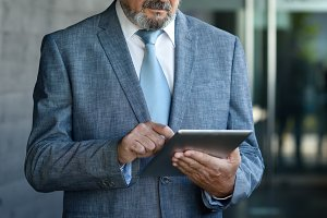 Senior businessman with tablet