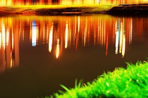 Colorful lights reflections on lake surface background