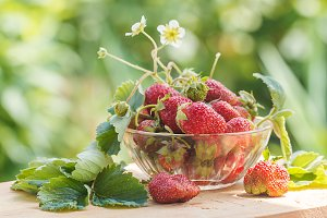 Ripe strawberries with leaves