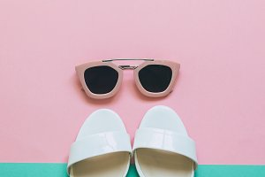 sunglasses and white sandals.