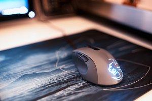 Computer mouse on mousepad bokeh backdrop