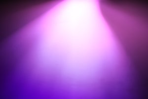 Diagonal purple pink light from top bokeh background