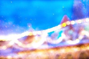 Diagonal bokeh snow with light leak background