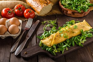 French omelet, fluffy, fresh eggs and herbs