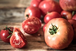 ripe Tomatoes on wooden background close-up