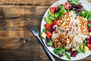 Warm Salad from Brown Rice, Quinoa, Prawns, Halloumi and Veg