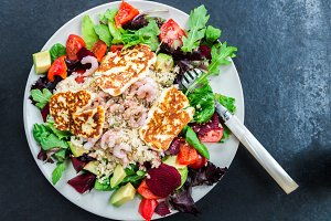 Warm Salad from Brown Rice, Quinoa, Prawns, Halloumi and Veg
