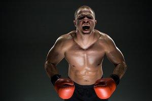 Muscular man screaming and roar