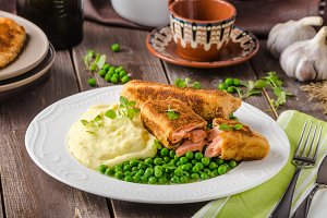 Fried salmon with mashed potato and vegetable