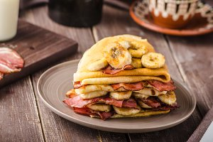 Pancakes with bacon, banana and maple sirup