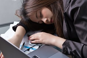 Business woman sleep in work desk