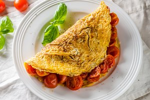 Rustic omelet with tomato