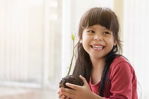 Happy Asian girl and seed.