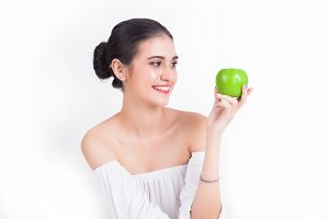 Woman and green apple