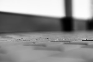 Horizontal black and white pavement bokeh background