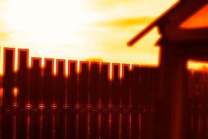 Vertical sunset fence bokeh background