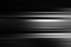 Horizontal black and white futuristic motion blur background