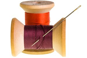 Two spools of thread and needle