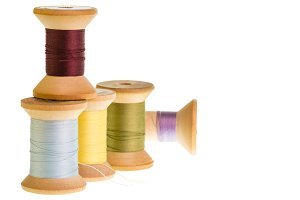 Spools of sewing thread on white