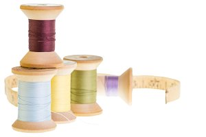 Spools of thread and tape measure