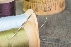 Sewing tape and spools of thread
