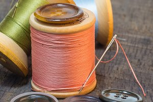 Buttons and needle with thread