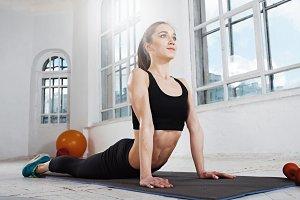 Beautiful slim brunette  doing some gymnastics a the gym