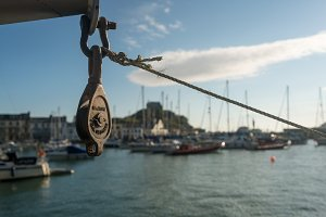 Old iron pulley on winch in front of harbour at Ilfracombe, Devon