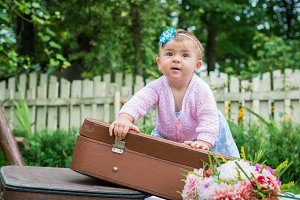Little girl on suitcase