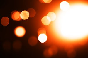 Orange light leak bokeh background
