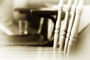 Diagonal sepia vintage chair bokeh background