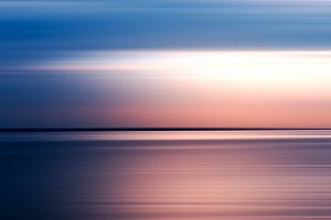 Horizontal pink and blue motion blur background