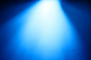 Diagonal blue light from top bokeh background