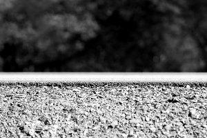 Black and white road-bed transportation embankment background