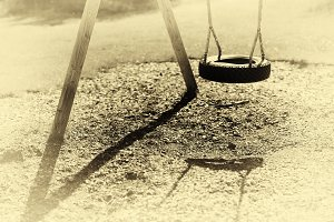 Norway children swing from tire sepia background