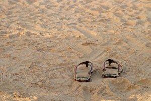 Sandals on Sand Beach