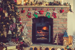 Christmas setting, decorated fireplace, fur tree
