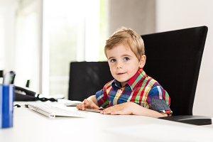 Little Boy Working In Office