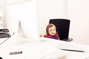 Little Girl Working In Office