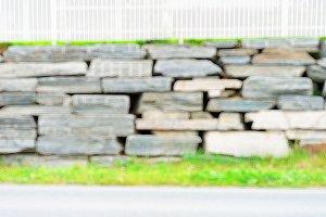 Horizontal stone wall bokeh background