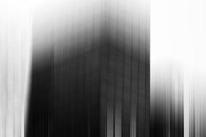 Vertical black and whites skyscraper blur background